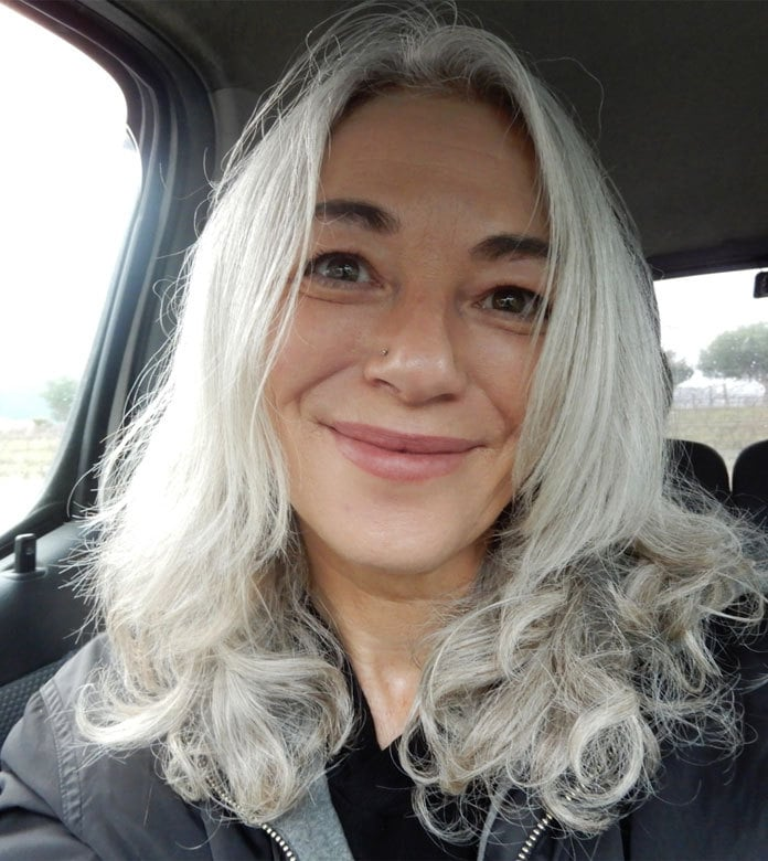 pretty smiling woman long gray hair curly