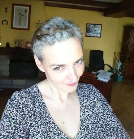 image of woman short gray hair braids