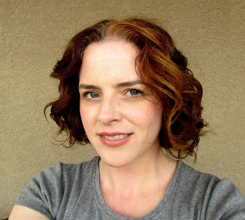 image of pretty woman with gray roots and red hair