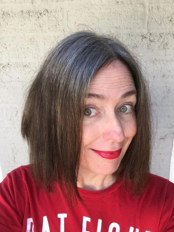 image of woman in red shirt with extreme silver overtone in hair