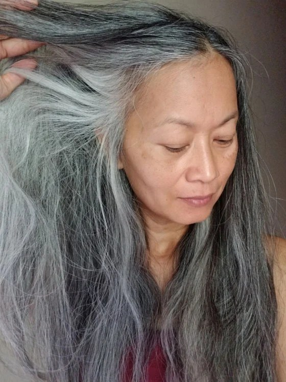 image of Asian woman no makeup long gray hair