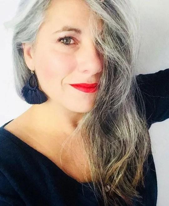 image of gray hair woman navy earrings
