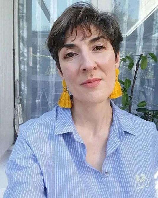 image of pretty woman yellow earrings