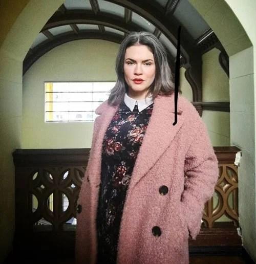 image of woman gray hair pink coat