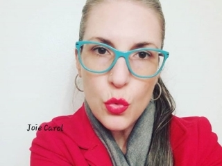 image of pretty woman grey hair red lips blue glasses