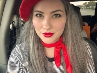 image of young woman long gray hair red beret and red scarf