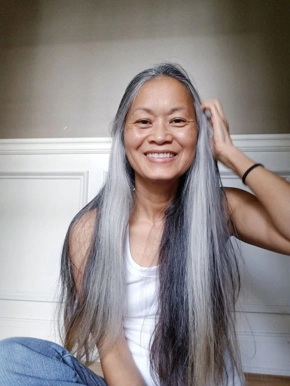 image of Asian woman long gray hair