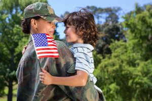 image of soldier and kid