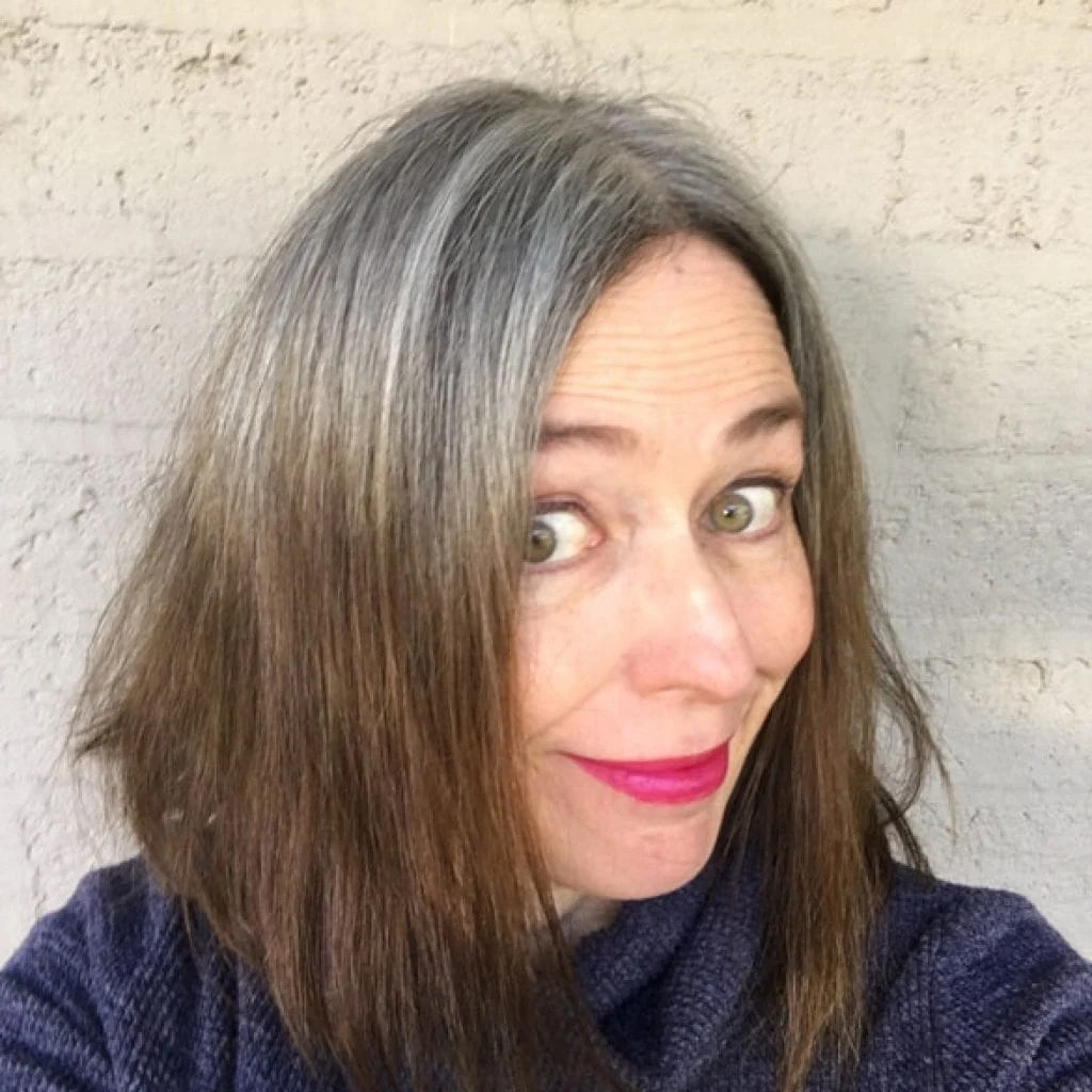 image of brunette woman 10 months going gray