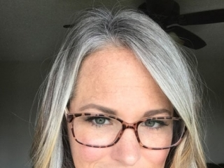 image woman long gray roots and blonde ends