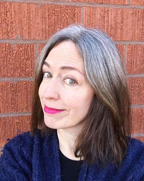 image woman gray roots long brown hair