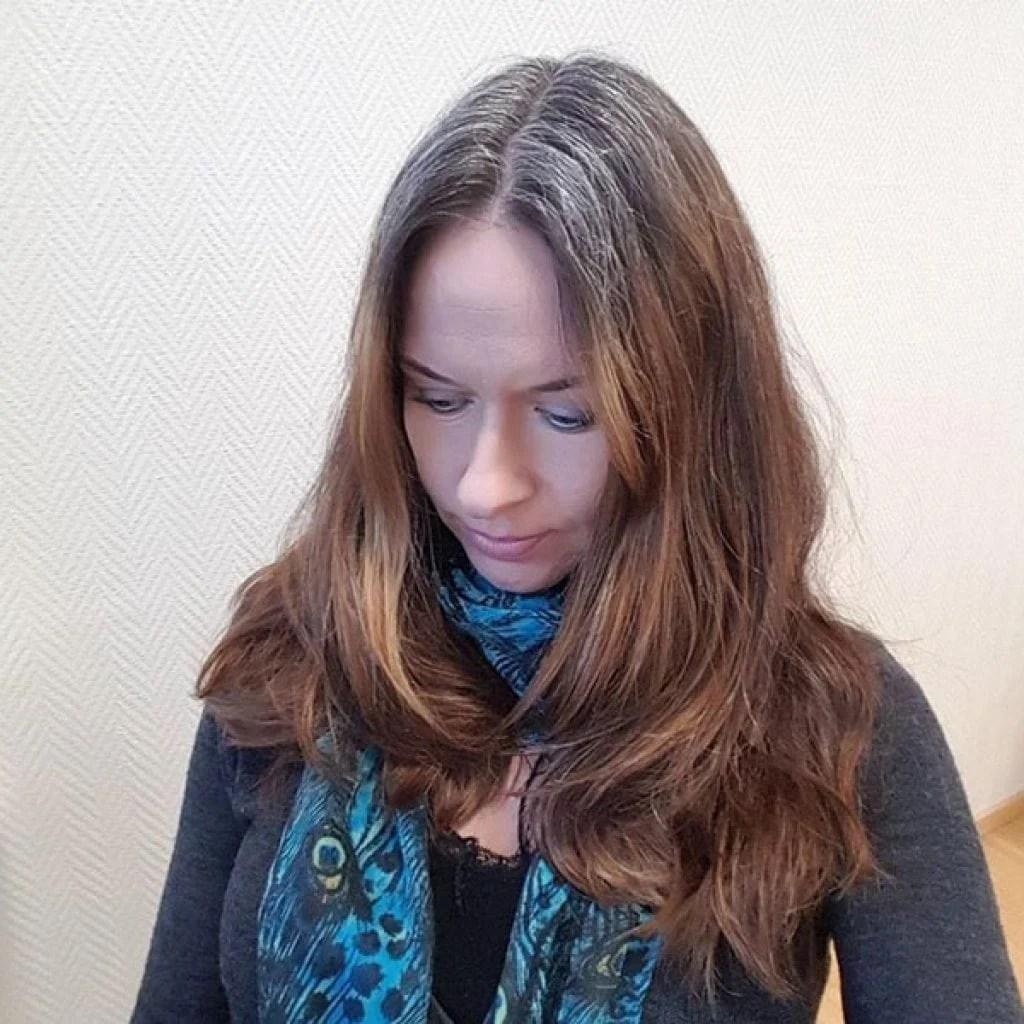 woman long brown hair gray roots