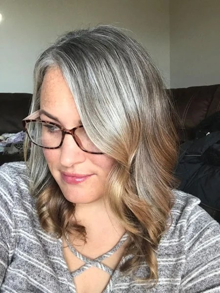 image woman long gray roots blonde ends