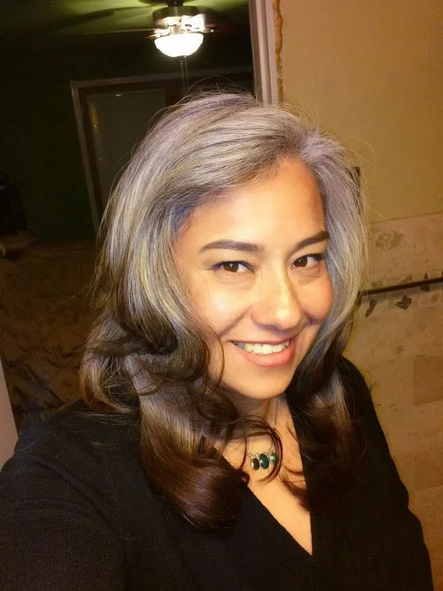 image of latina woman transitioning gray hair