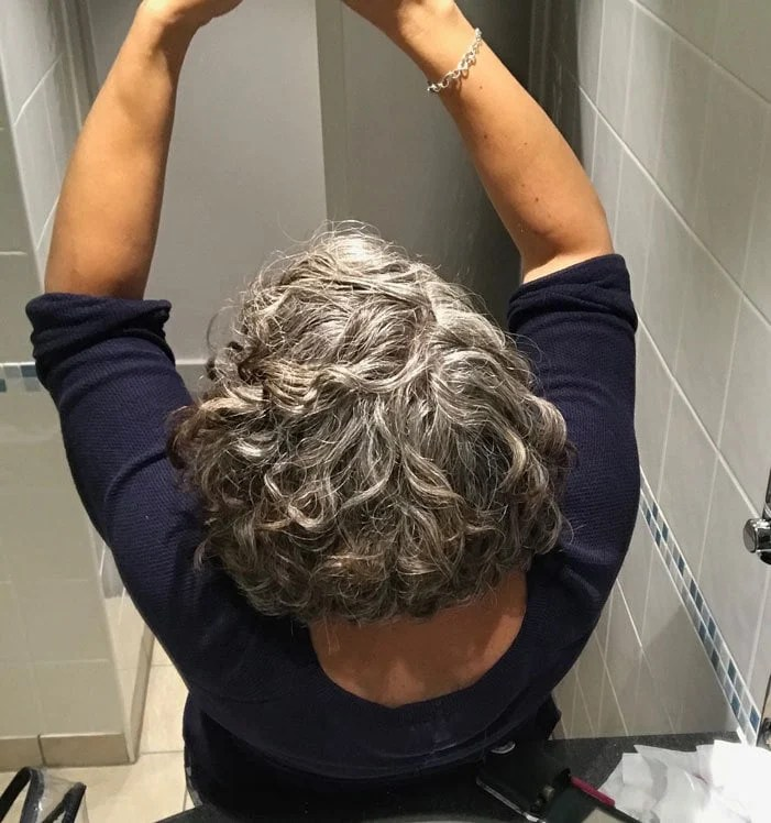 image of woman with gray curls taking selfie