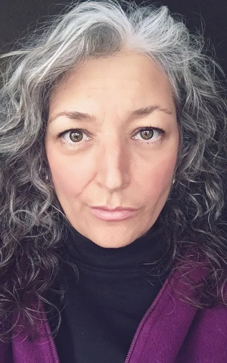 image of woman long gray curly hair