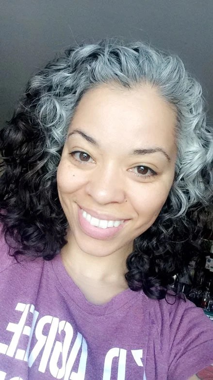 image of beautiful black woman transitioning to gray curly hair