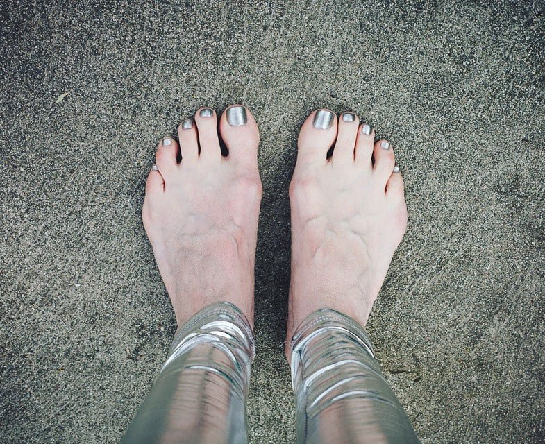image of silver leggings and toenails