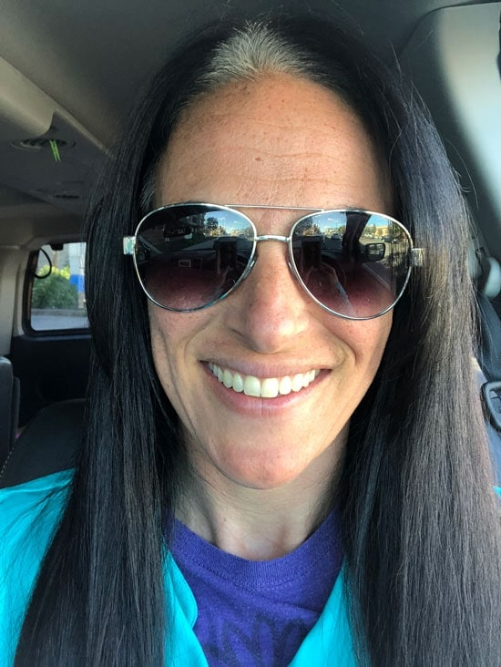 image of woman dark straight hair and gray roots