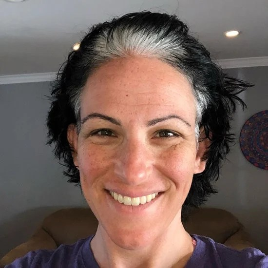 image of woman white roots black dyed short hair