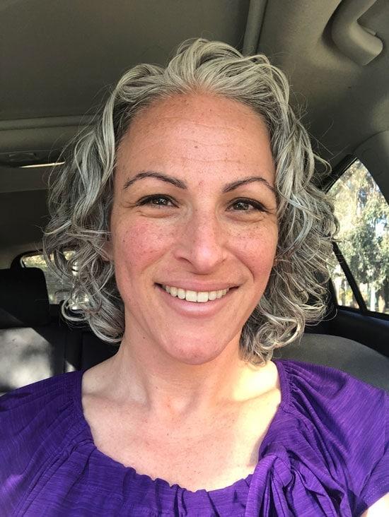 image of woman gray curly hair bob