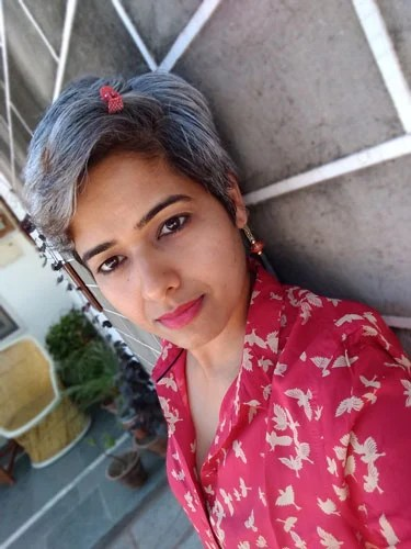 image of young Indian woman with short gray hair