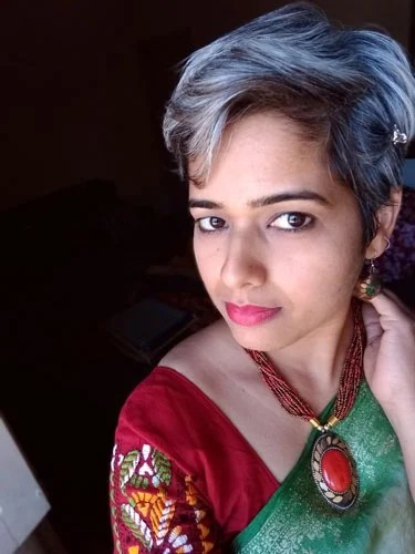 image of young Indian woman with short salt and pepper hair