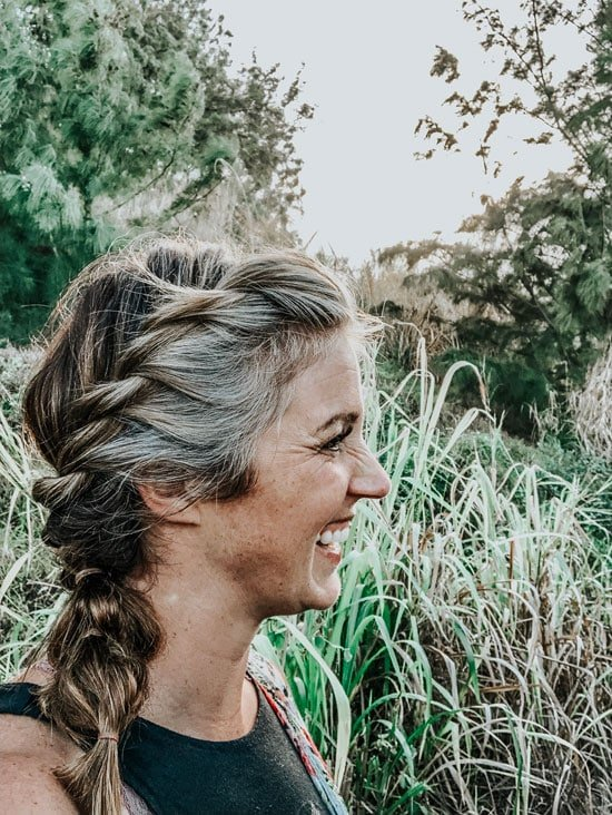 image of happy woman grey braid
