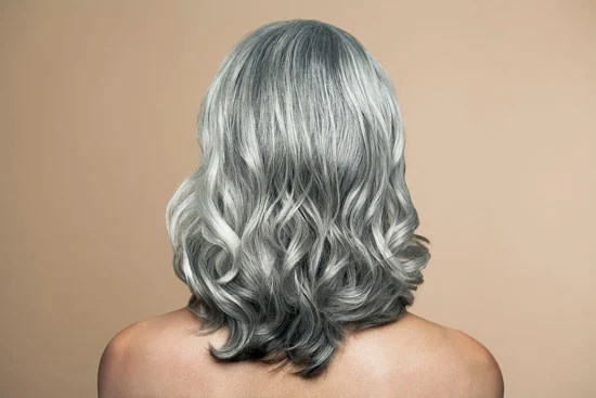 image of woman with lovely silver hair curls