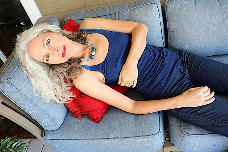 image of woman lying down with white hair red lips