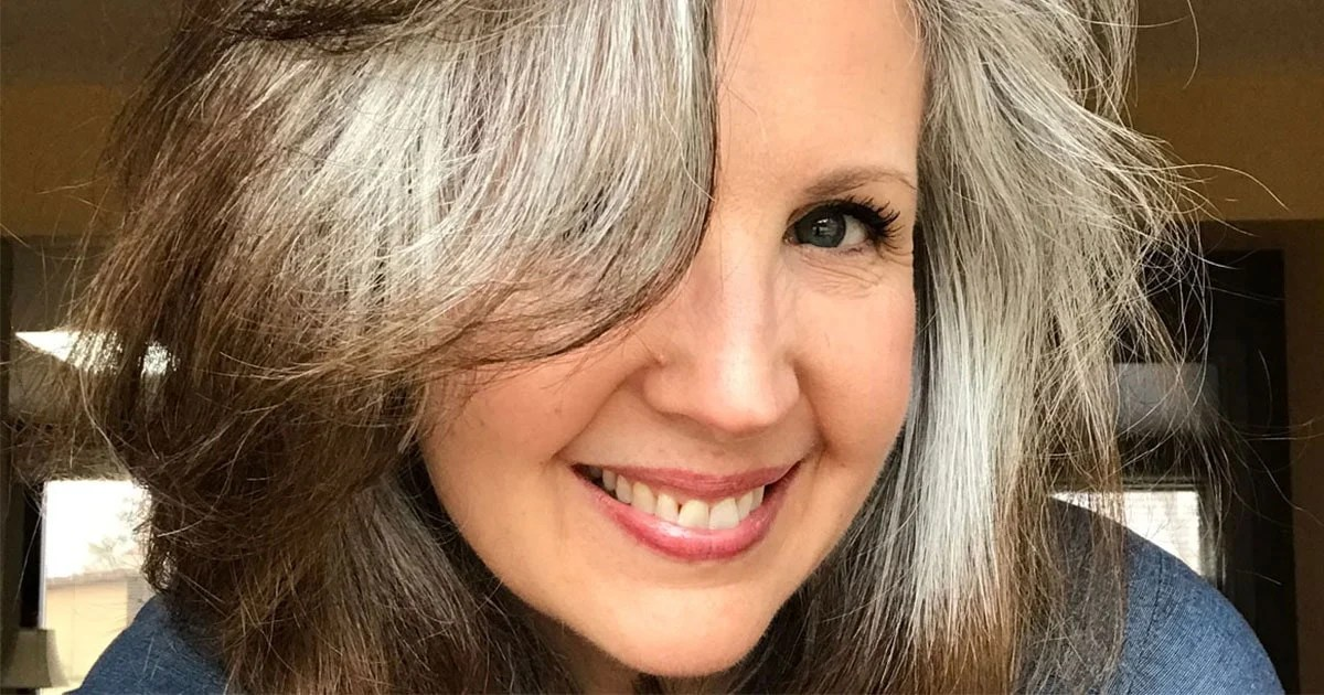 image of woman with gray hair at 52