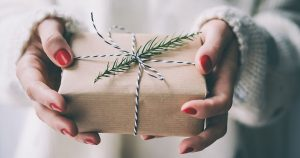 image of hands holding present