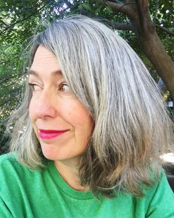 image of woman with transition to gray hair