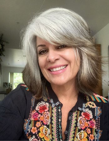 image of woman growing out gray hair
