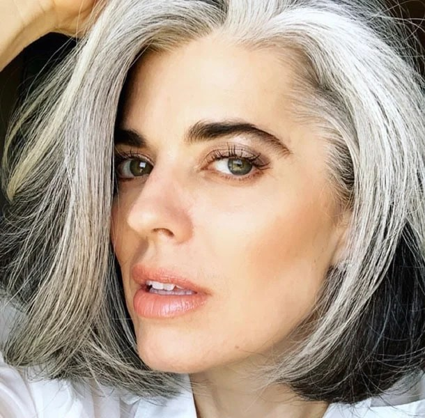image of woman with gray hair dark eyebrows