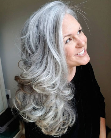 image of woman super long gray curly hair