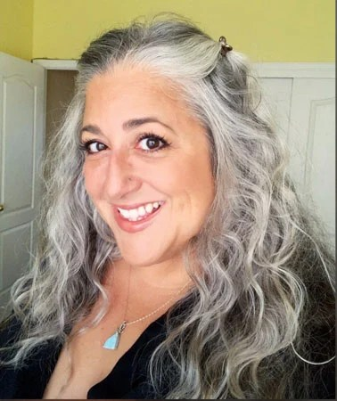 image of woman with wavy gray hair