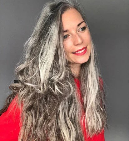 image of young woman with long wavy silver hair
