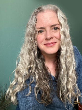image of woman with long curly gray hair