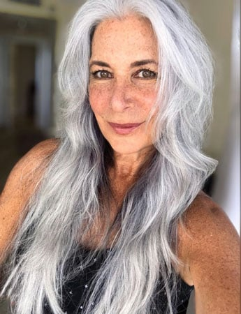 image of woman with long natural silver hair