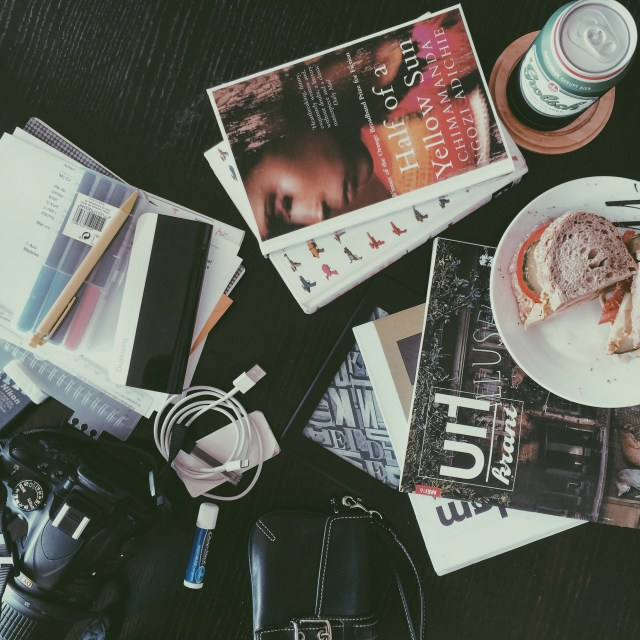 the hastily dumped deposits of my bag included my camera, proofreading pens and my newest library books, Chimamanda Ngozi Adichie's Half of a Yellow Sun and Charles Yu's How to Live Safely in a Science Fictional Universe. Beer and sandwich not included in bag...
