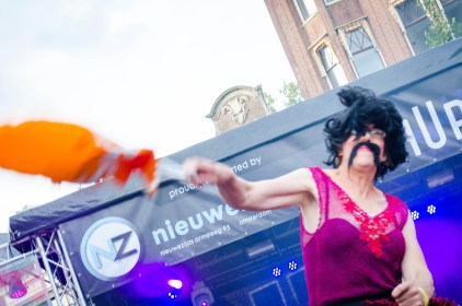 one of the queens competing in the Hand Bag Toss at the 2016 Drag Queen Olympics celebrating Gay Pride in Amsterdam