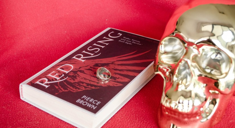 Red Rising by Piece Brown is the first in a trilogy and follows Darrow as he tries to escape his upbringing and fulfill his destiny.
