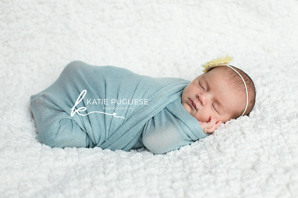 Newborn Baby girl wrapped in blue