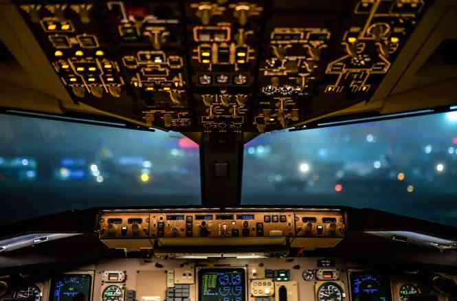 View inside of a jet cockpit at night, with tight focus on the controls.