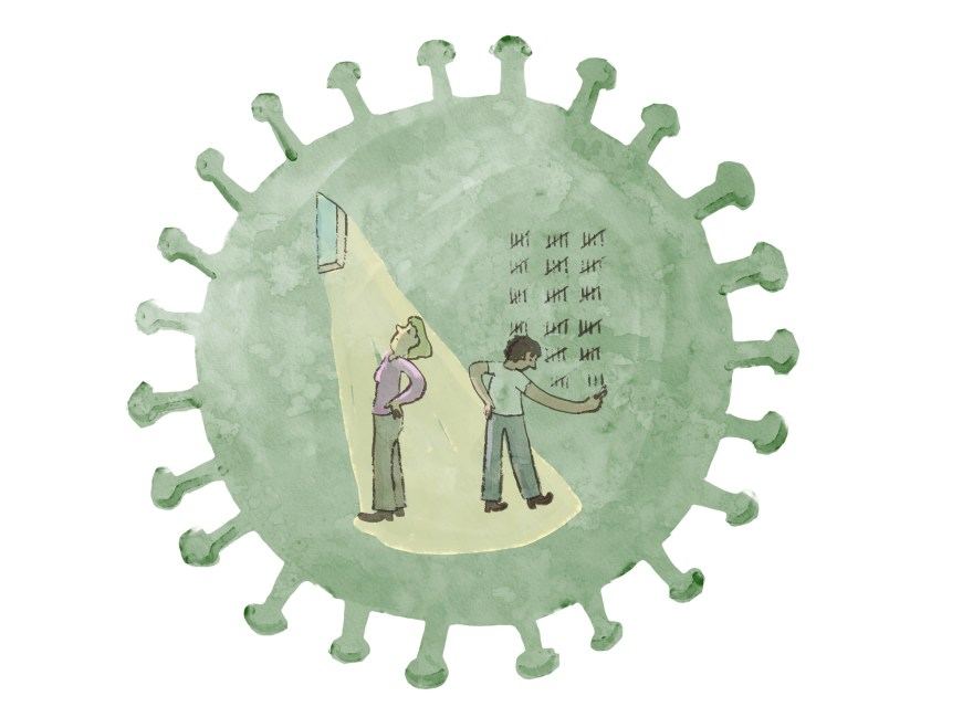 Two people are prisoners inside a cell. The cell is in the shape of a round coronavirus cell.