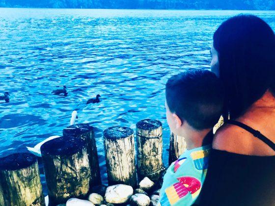 Me and Harvey looking out on the lake at lake garda,