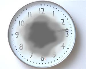 A clock with the middle portion blurred out due to central vision loss.