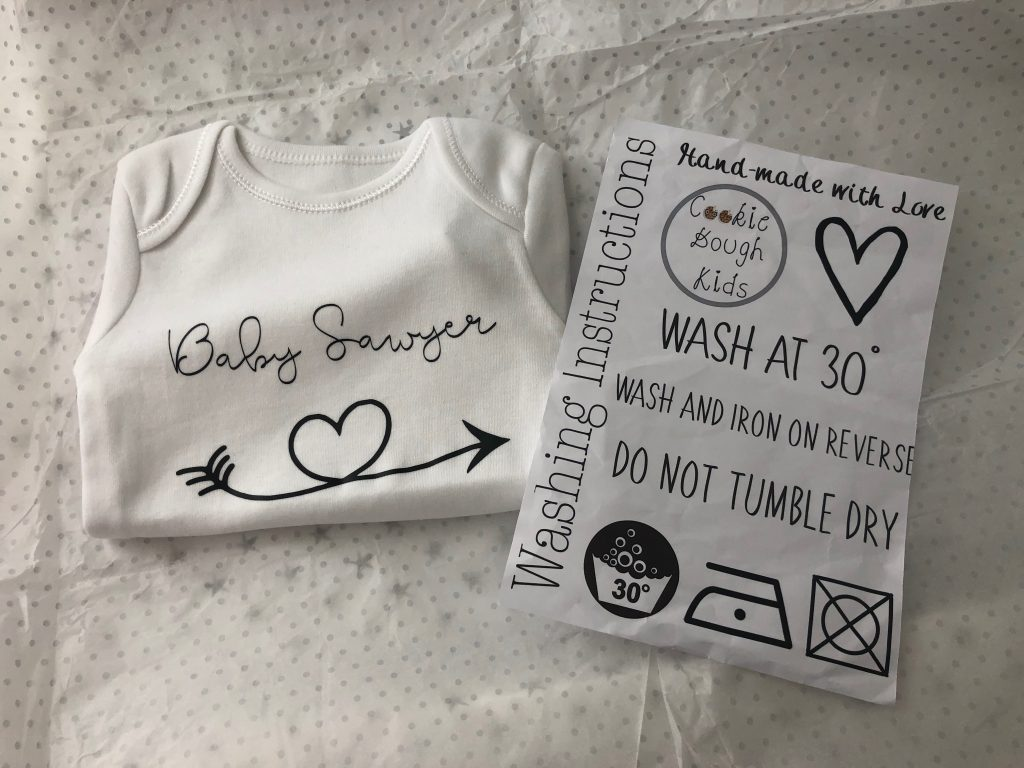 Baby Grow with Washing Instructions
