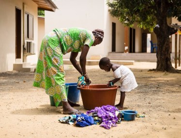 Helpin her mamma do the laundry